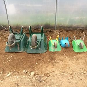A family of wheelbarrows.