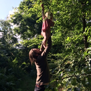 Picking wild plums in the food forest
